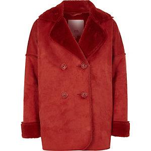Donkeroranje jas met imitatieschapevacht voor meisjes