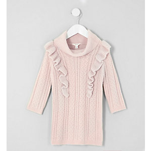 Robe pull en maille torsadée rose à volants mini fille