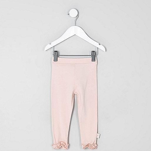 Mini girls light pink ruffle hem leggings