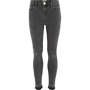 Girls black released hem skinny fit jeans