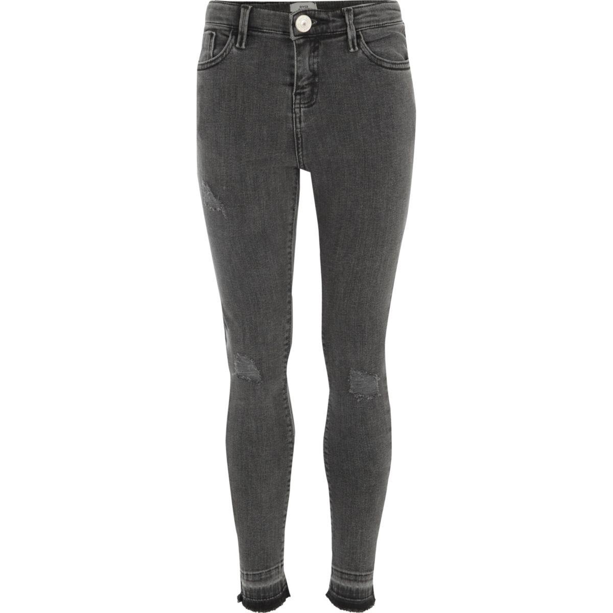 Girls black released hem skinny fit jeans