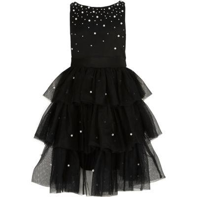 River Island Zwarte jurk met gesmokte tule rok en parels voor meisjes