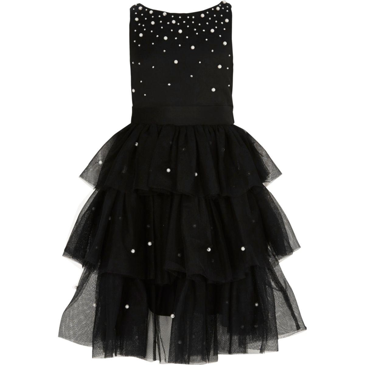 Schwarzes Kleid mit Tüllrock und Perlenverzierung