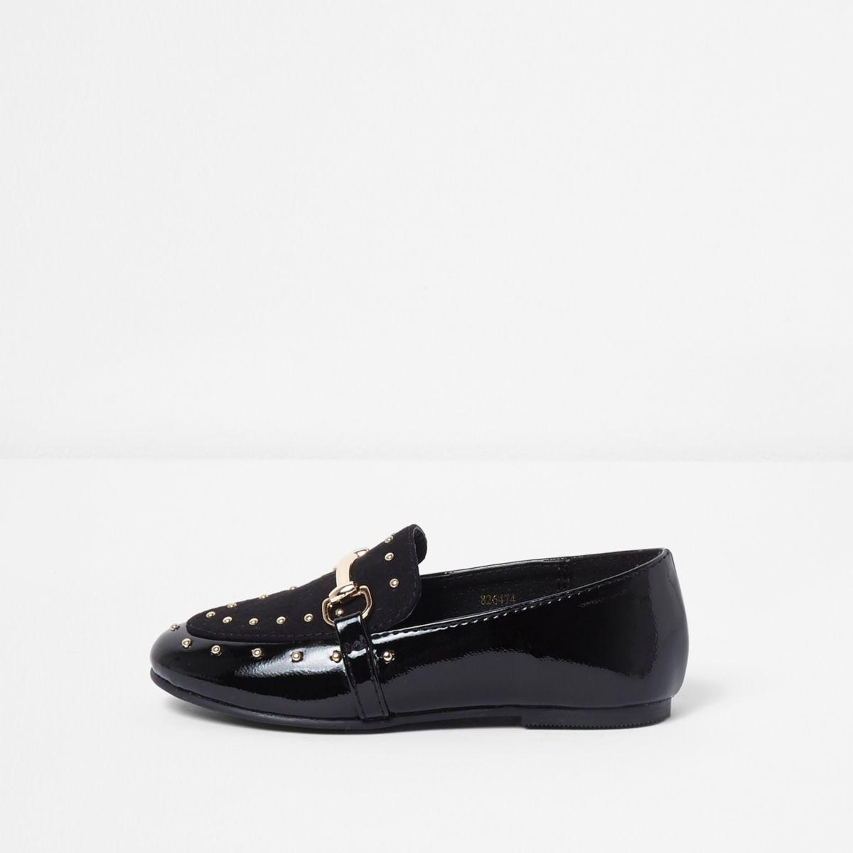 Schwarze, nietenverzierte Loafer