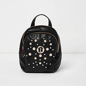 Kleiner, schwarzer Rucksack mit Glitzer und Kunstperlen