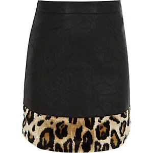 Girls black faux leather leopard print skirt