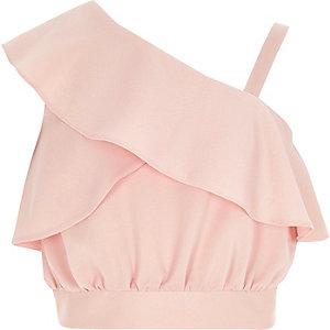 Roze crop top met een blote schouder en ruches voor meisjes