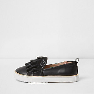 Girls black ruffle top slip on plimsolls