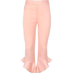 Girls black asymmetric frill hem trousers