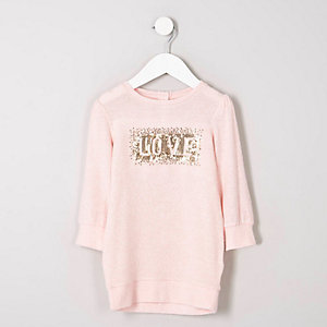 Robe pull rose motif Love en sequins mini fille