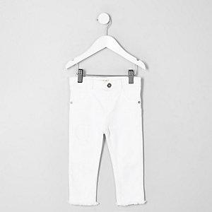 Jean skinny blanc effet déchiré et recousu mini fille