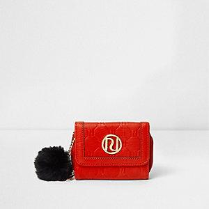 Porte-monnaie rouge à deux petits rabats et logo RI en relief pour fille