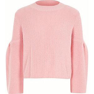 Roze pullover met strik en uitsnede op de rug voor meisjes