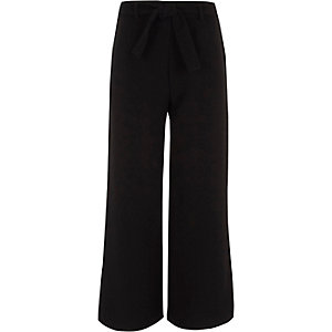 Girls black wide leg split palazzo trousers