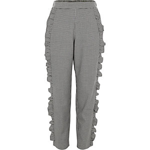 Girls grey dogtooth check ruffle trousers