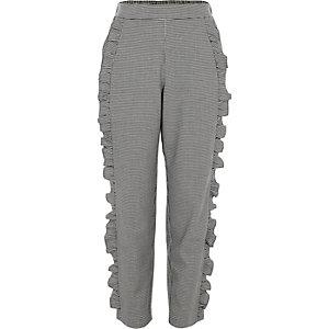 Girls grey dogtooth check ruffle trousers