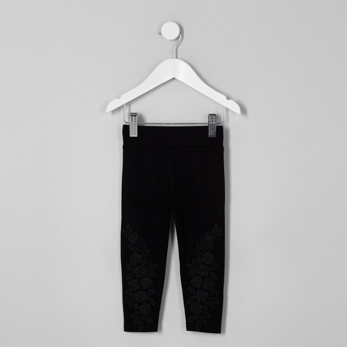 Schwarze Leggings mit Spitzenapplikation