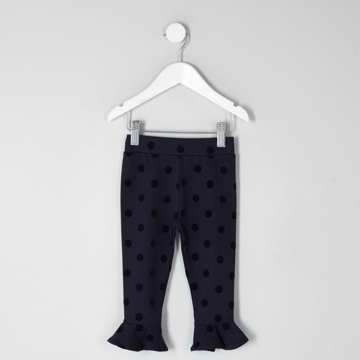 Mini girls navy flocked polka dot leggings