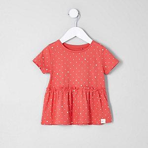 Rotes T-Shirt mit Schößchen und Punktemuster für Mädchen