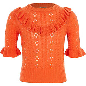 Pull en maille pointelle orange à volants fille