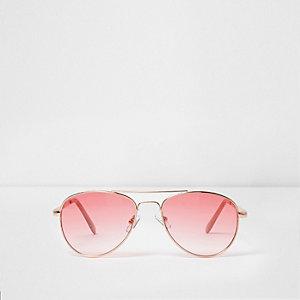 Pinke Pilotensonnenbrille mit transparenten Gläsern