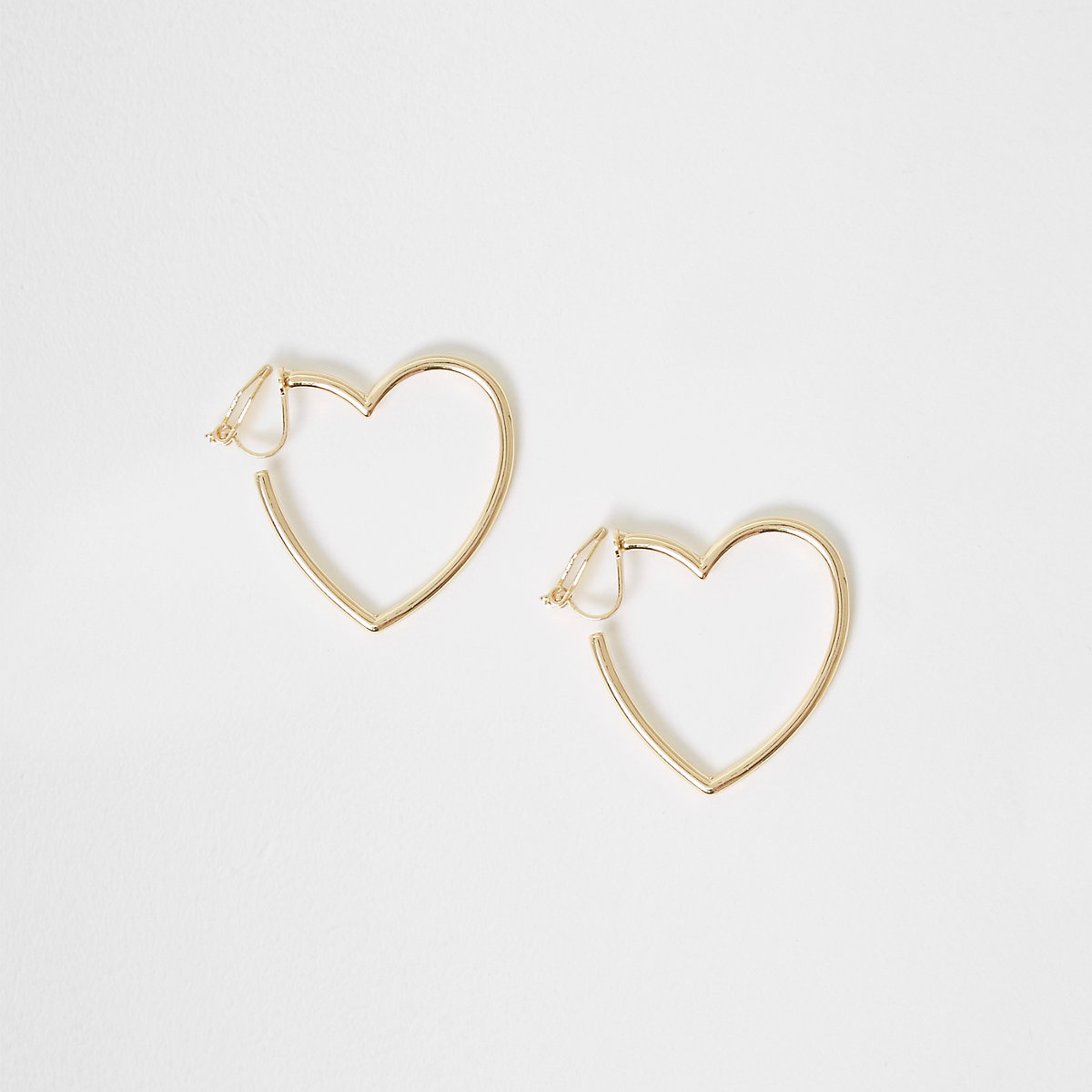 Girls gold tone heart shaped clip on earrings