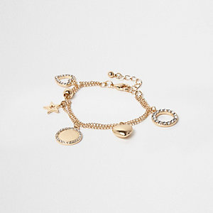 Girls gold tone charm bracelet