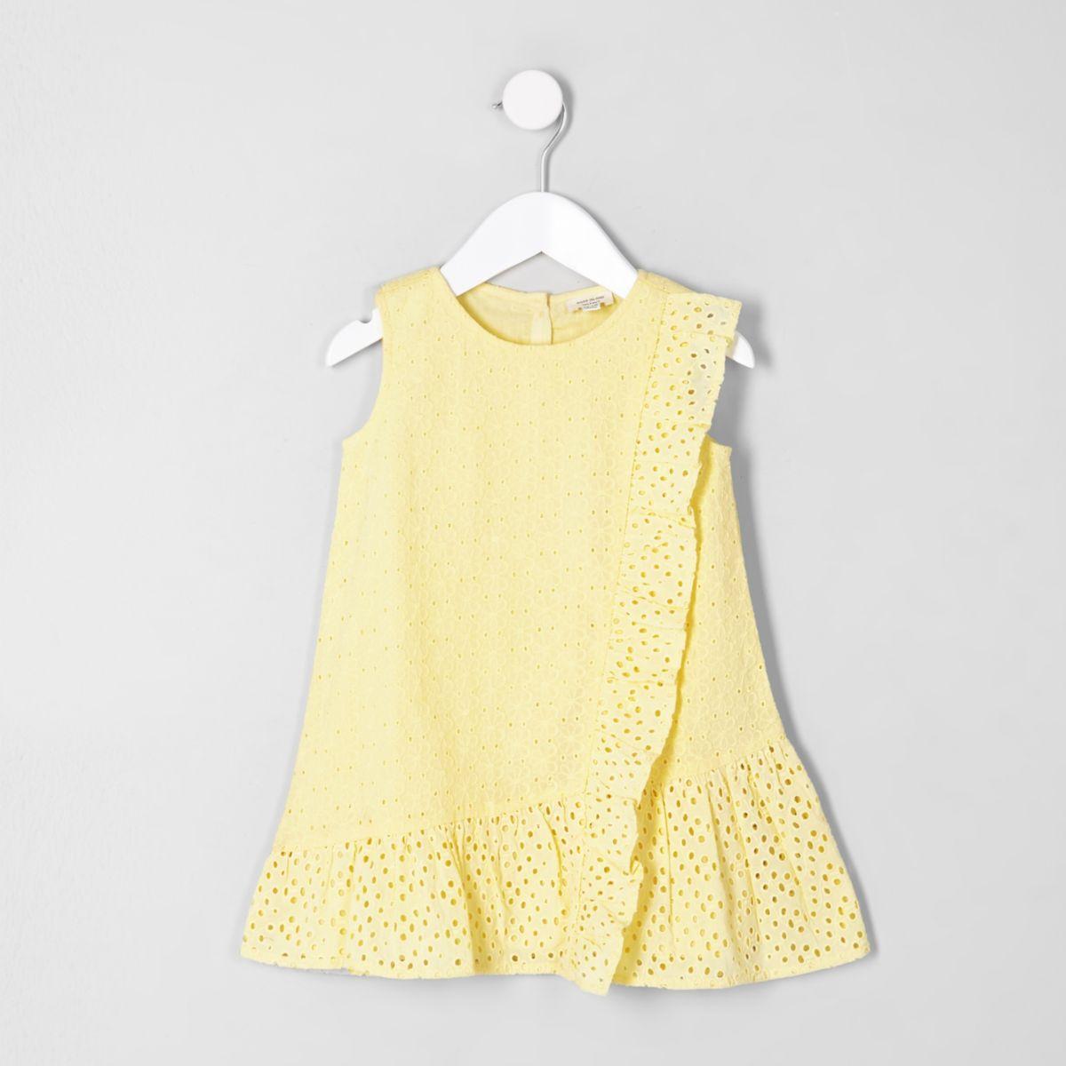 Mini girls yellow broderie peplum hem dress