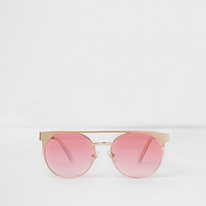 Goldene Sonnenbrille mit pinkem Steg