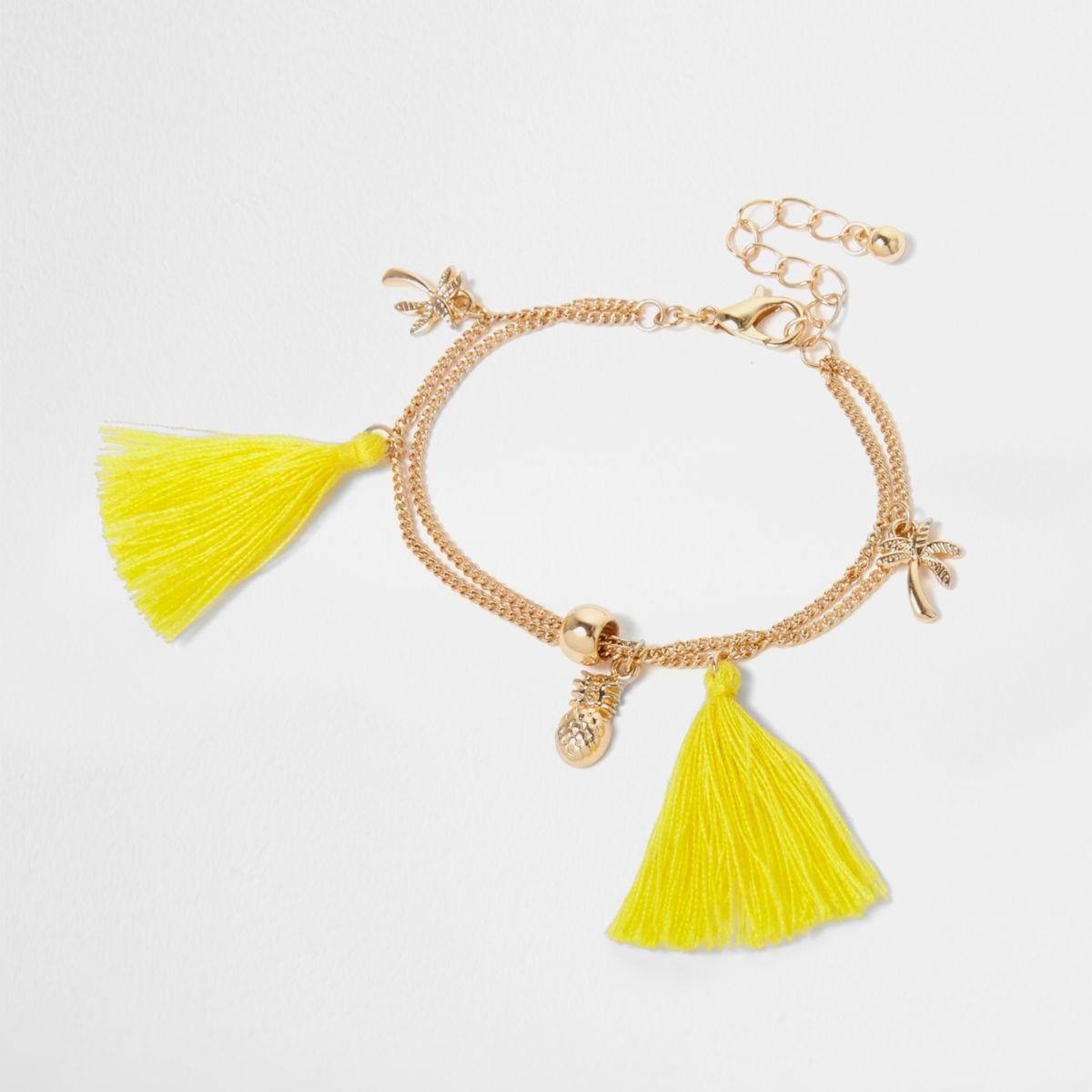 Girls gold tone charm tassel bracelet