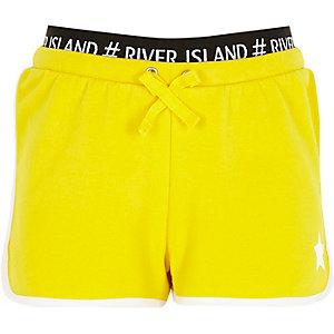 Gele hardloopshort met RI-logo op tailleband en sterprint  voor meisjes