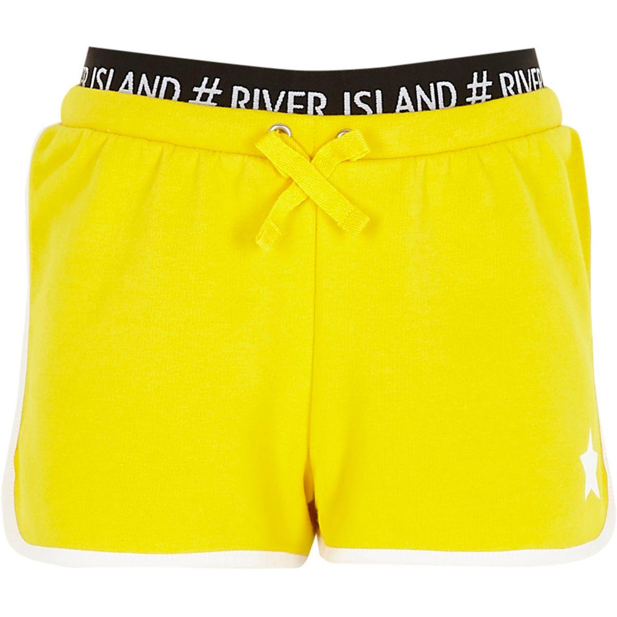 Short de course jaune avec logo RI à la taille et motif étoile pour fille