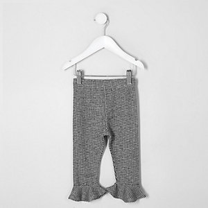 Mini girls black dogtooth check leggings