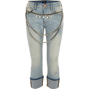 Girls blue chain belt turn up skinny jeans