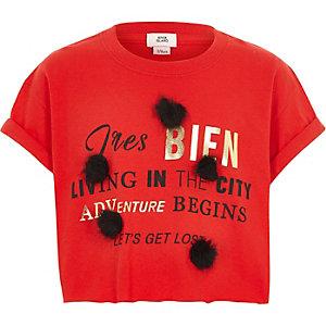 Rood T-shirt met pompons en 'tres bien'-print voor meisjes