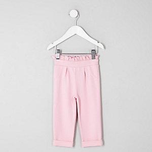Pantalon rose à volants à la taille mini fille