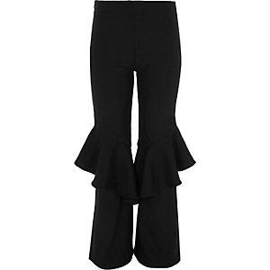 Schwarze, ausgestellte Leggings mit Rüschen