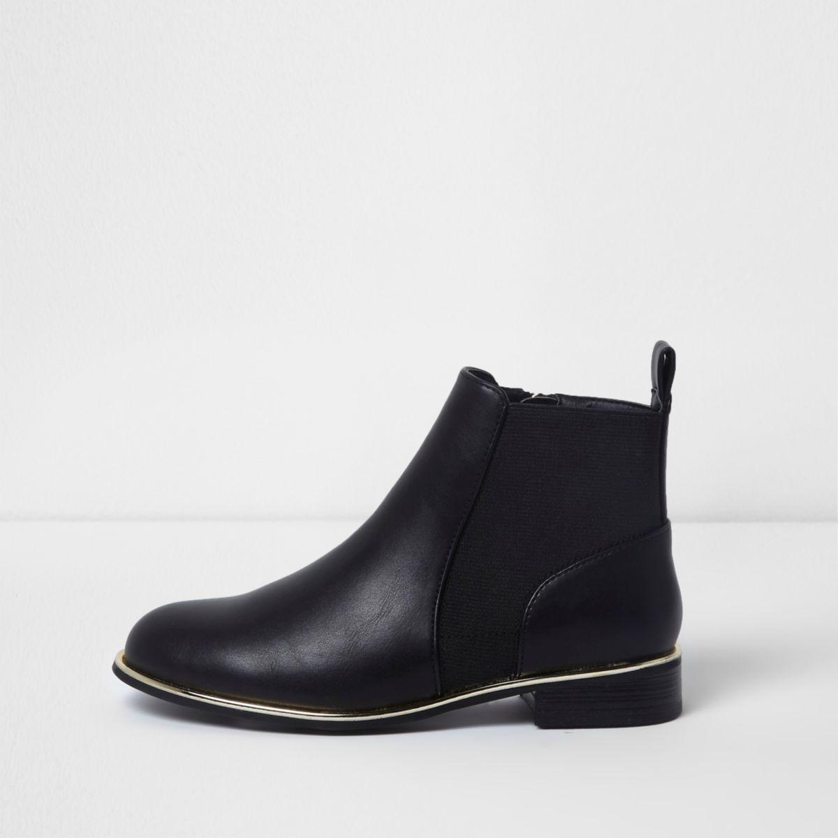 Schwarze Chelsea-Stiefel mit goldener Verzierung