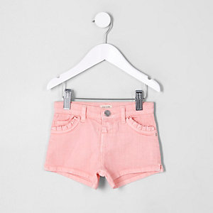 Short en denim rose à poches à volants mini fille