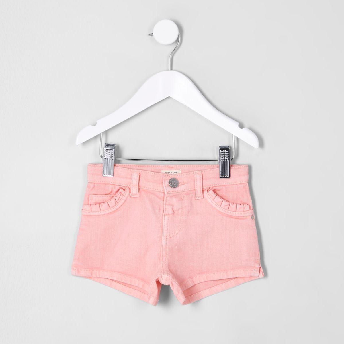 Short en denim rose à poches à volants mini fille