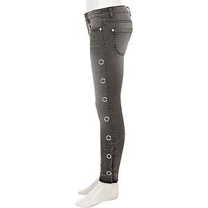 Amelie - Zwarte skinny jeans met drukknopen opzij voor meisjes