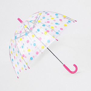 Rosa Regenschirm mit Punkten