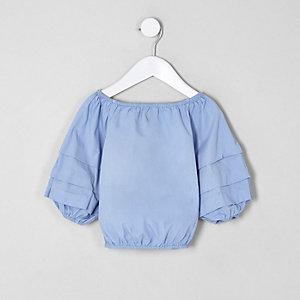 Top bleu à manches bouffantes mini fille