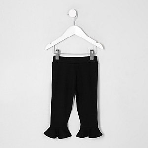 Mini girls black frill hem leggings