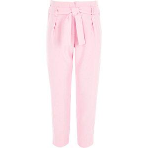 Roze smaltoelopende broek met strikceintuur voor meisjes