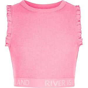 Roze geribbelde crop top met RI-logo op de zoom en ruches aan de mouwen voor meisjes