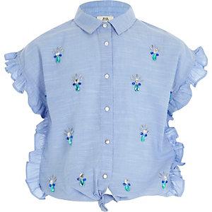 Chemise bleue ornée à volant noué sur le devant pour fille