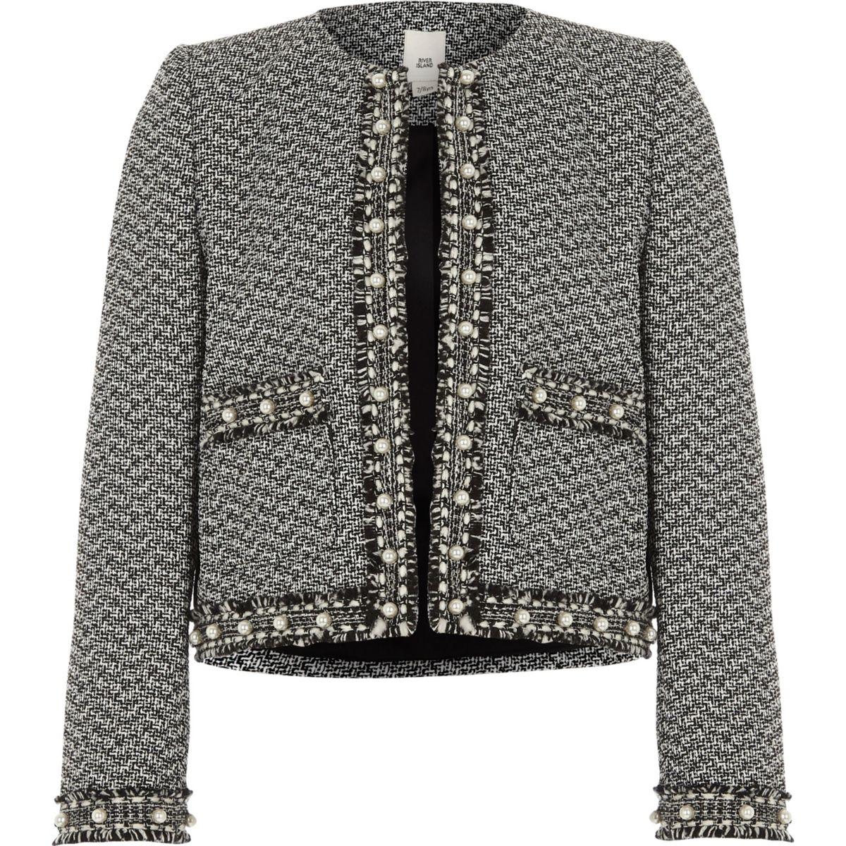 Schwarze Jacke mit Perlenverzierung