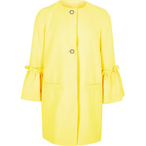 Girls yellow frill cuff pearl button coat