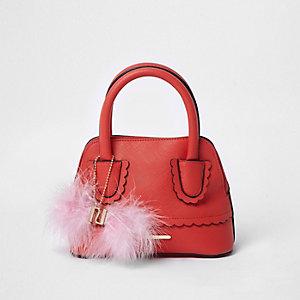 Rode handtas met geschulpte afwerking en pompons voor meisjes